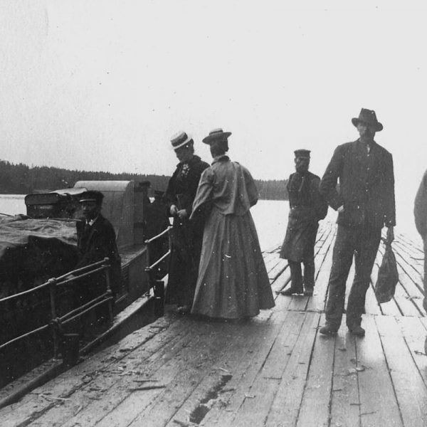 A boat, a pier and six people