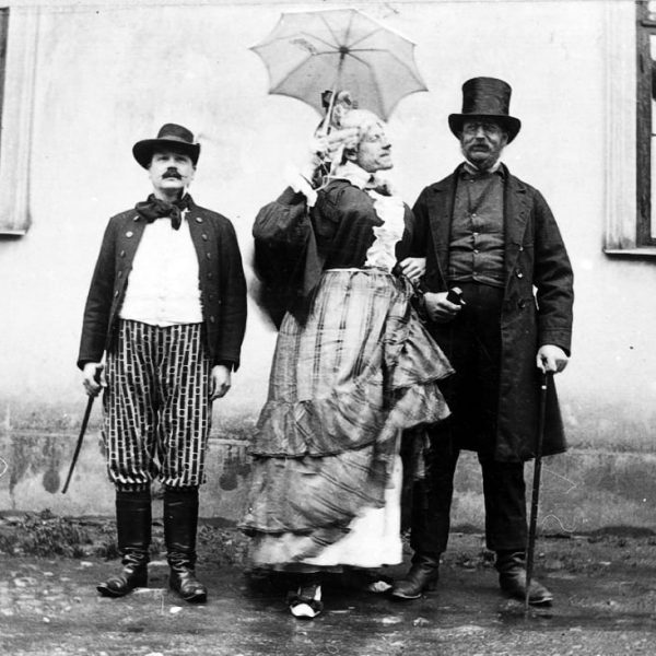 Three people in dress up.