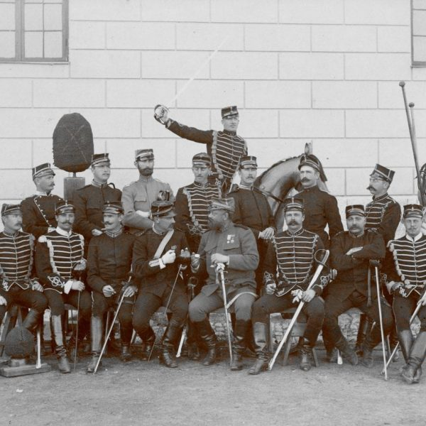Sixteen officers in uniform.