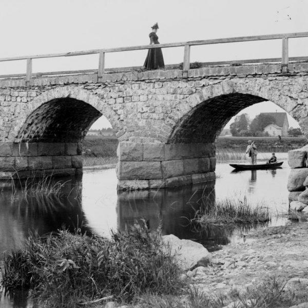 A woman on a bridge