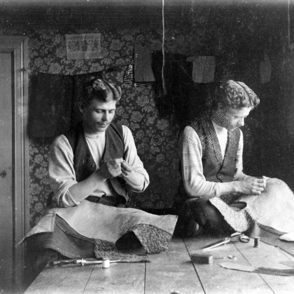 Two tailors on a table