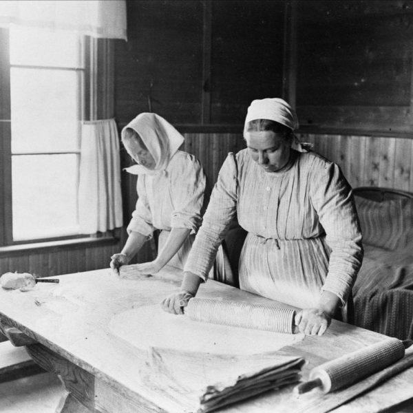 Two women baking thin bread