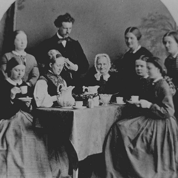 A company of nine at a table