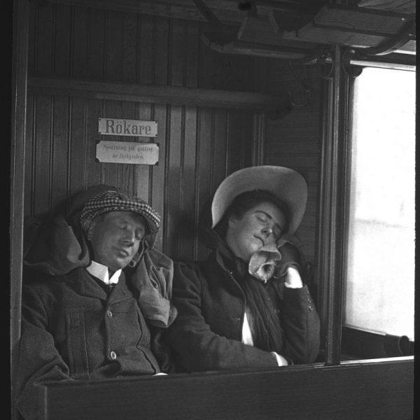 A couple sleeping in a train car.