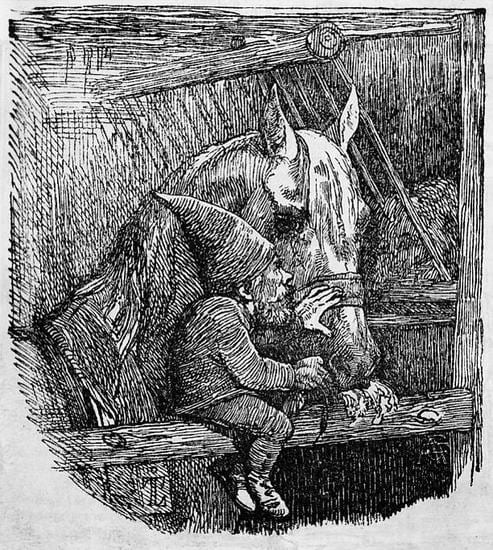 A tomte sits on a pole in a stable and pets an eating horse on its nose.